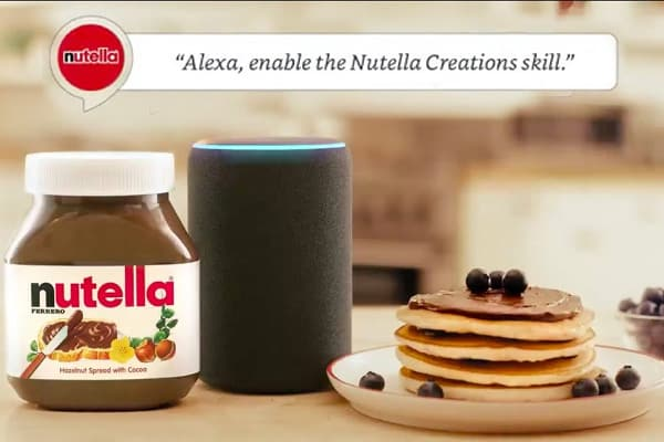 Nutella jar, pancakes, an Amazon Echo device and text saying Alexa enable the Nutella Creations skill